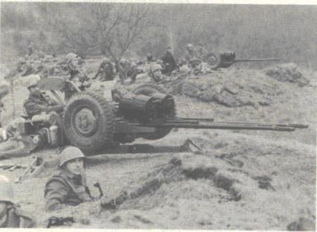 Yugoslav People's Army soldiers aiming anti-aircraft guns  at Visegrad. April 1992.