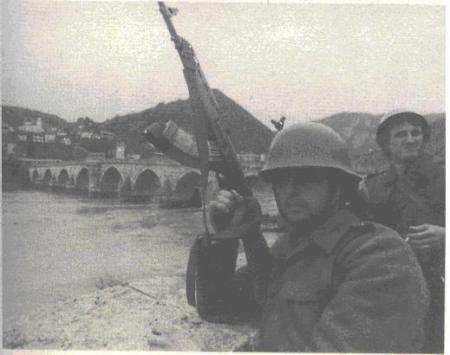 Yugoslav People's Army soldiers at the Mehmed-pasa Sokolovic Bridge which was later used as an excecution site by Serb paramilitaries.