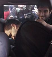 Milan Lukic led away in a police car in Argentina after being arrested.