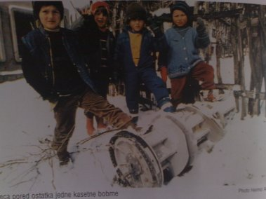 Bosniak children stand by remains of a  cluster bomb which was aimed at civilian objects in Gorazde.