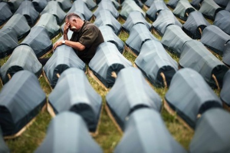 A Muslim cries beside the coffin of his son among 534 newly identified victims of the 1995 Srebrenica massacre lined up for a joint burial in Potocari July 10, 2009. Each year, bones are matched to a name and buried in a mass funeral on July 11, the anniversary of the Srebrenica massacre of up to 8,000 Muslim men and boys by the Bosnian Serb forces.  REUTERS/Damir Sagolj   (BOSNIA AND HERZEGOVINA SOCIETY IMAGES OF THE DAY)