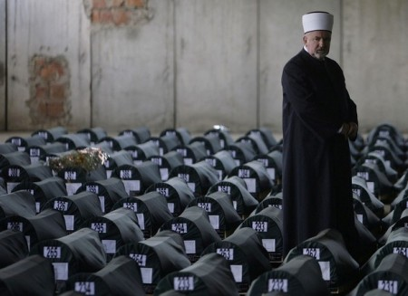 Mustafa Ceric, the Grand Mufti of Bosnia's Muslims, walks among coffins of 534 newly identified victims of the 1995 Srebrenica massacre lined up for a joint burial in Potocari July 10, 2009. Each year, bones are matched to a name and buried in a mass funeral on July 11, the anniversary of the Srebrenica massacre of up to 8,000 Muslim men and boys by the Bosnian Serb forces.  REUTERS/Dado Ruvic   (BOSNIA AND HERZEGOVINA SOCIETY)